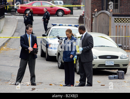Police investigate a murder crime scene on a city street, Boston, Massahcusetts - Stock Photo