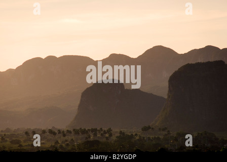 Evening light over the steep limestone hills in the valley of Viñales in Cuba - Stock Photo