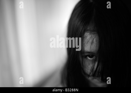 Haunting child Five year old girl in homage to the movie The Grudge - Stock Photo
