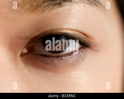 A close up of a young Asian's eye. - Stock Photo