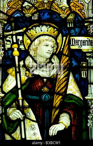 St Margaret of Antioch portrayed in the south window of St George church Woolhope Herefordshire - Stock Photo