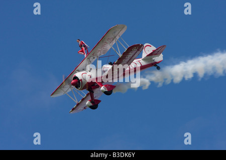 Boeing Stearman PT 17 Kaydet of the Team Guinot wing walking display team at Sywell - Stock Photo