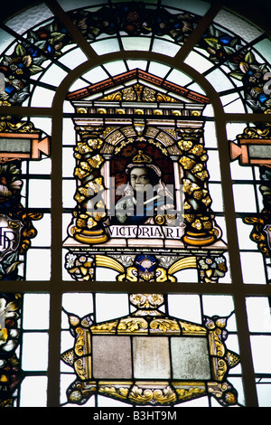 Stained glass window featuring Queen Victoria located in the Belfast City Hall. - Stock Photo