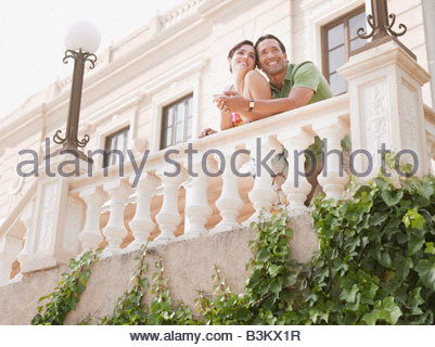 Couple hugging on balcony - Stock Photo