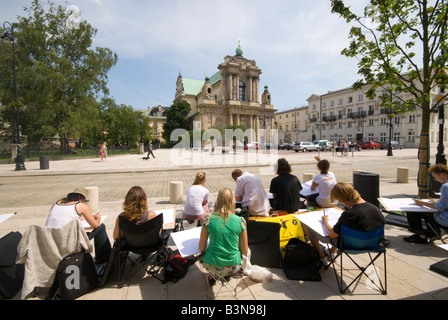 Students Drawing on Krakowskie Prezmiescie Warsaw - Stock Photo