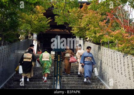 Japan, Hiroshima prefecture, Miyajima island. Women on steps dressed in kimono for tea ceremony - Stock Photo