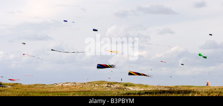 Kites fly on the beach at St. Peter Ording, Schleswig-Holstein, North Germany - Stock Photo