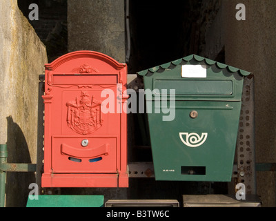 Europe, Italy, Camogli. Red and green mailboxes. - Stock Photo