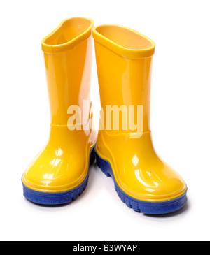 Yellow childrens wellington boots - Stock Photo