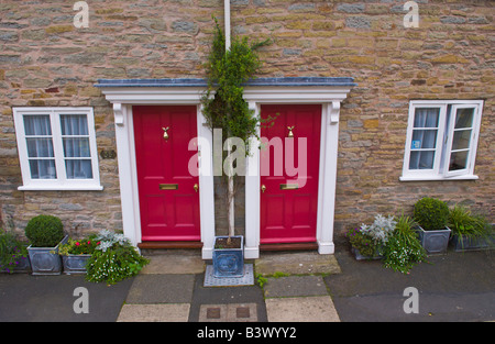 Pair of identical front doors on terraced cottages in Ludlow Shropshire England UK - Stock Photo