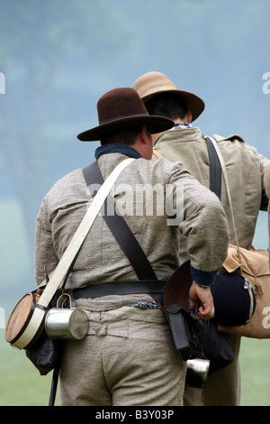 Two Confederate soldiers during a battle at a Civil War Encampment Reenactment - Stock Photo
