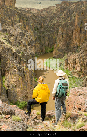 Idaho South Fork Owyhee River and Main Owyhee River couple takes in the view MR - Stock Photo