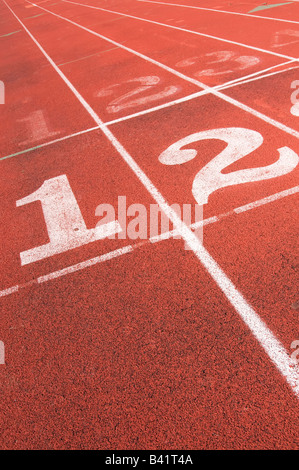 Numbered lanes on outdoor rubberized track - Stock Photo