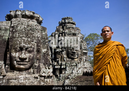 Monk in Temples of Bayon Angkor site Cambodia - Stock Photo