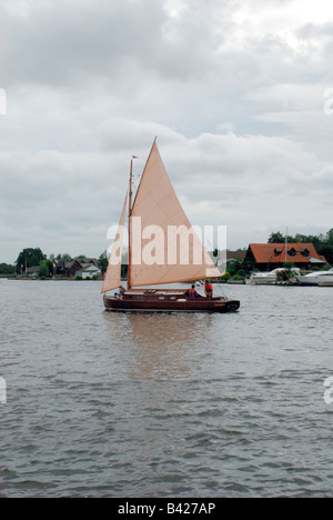 sailing boat on the river bure at horning,norfolk broads. - Stock Photo