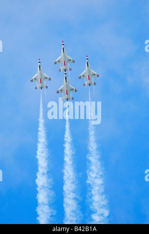 F-16 jet fighter of the aerobatic team Thunderbirds in flight at Elmendorf Air Force Base - Stock Photo