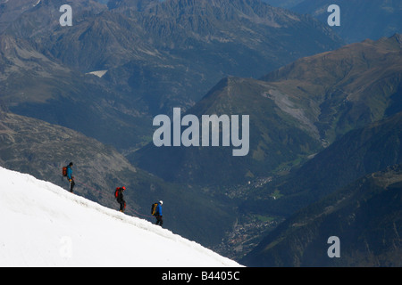 Mountaineers descend into the Vallee Blanche from the Aiguille du Midi, near Chamonix in the French Alps. - Stock Photo
