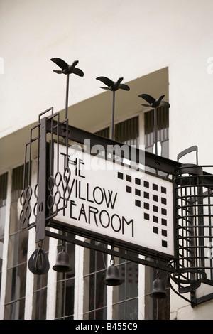 UK Scotland Glasgow Sauchiehall Street Willow Tearoom sign above Henderson Jewellers - Stock Photo