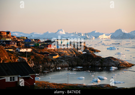 Aug 2008 - A view over houses and the Ilulissat Kangerlua Glacier also known as Sermeq Kujalleq Ilulissat Disko - Stock Photo