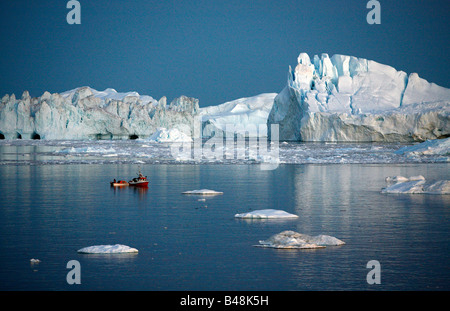 Aug 2008 - Fishing boat by the Ilulissat Kangerlua Glacier also known as Sermeq Kujalleq at Disko Bay Greenland - Stock Photo