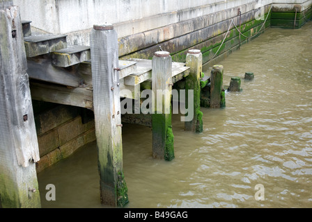 Stairway from London Bridge leading into the Thames River - Stock Photo