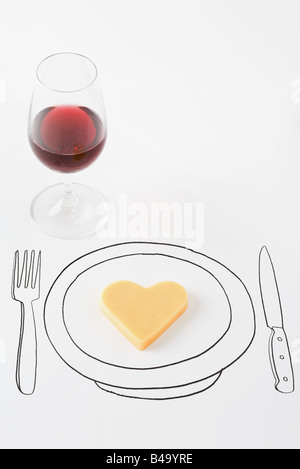 Heart-shaped cheese on drawing of plate, glass of red wine nearby - Stock Photo