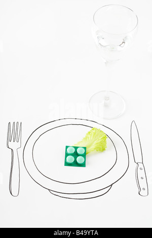 Pills and single leaf of lettuce on drawing of plate - Stock Photo