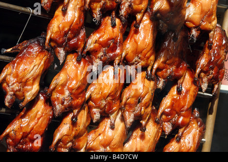 Crispy Fried Ducks hanging in the window of a Chinese restaurant China Town Gerrard Street London - Stock Photo