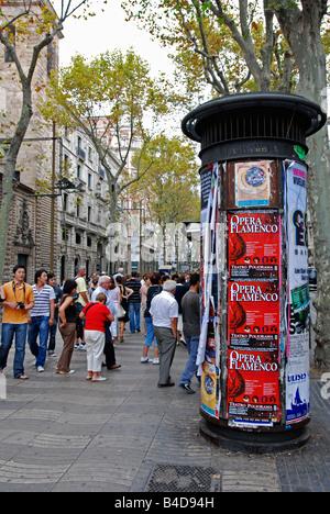 tourists walking along la rambla, barcelona, spain - Stock Photo