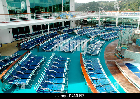 lounge chairs on pool deck of cruise ship royal caribbean 'adventure of the seas' - Stock Photo