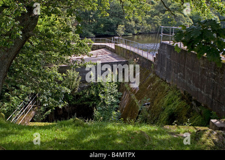 Outfall weir and reservoir with water going to small scale hydro electric power station Cynwydd North Wales - Stock Photo