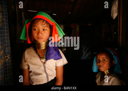 Two young Longneck girls indoors Approximately 300 Burmese refugees in Thailand are members of the indigenous group - Stock Photo