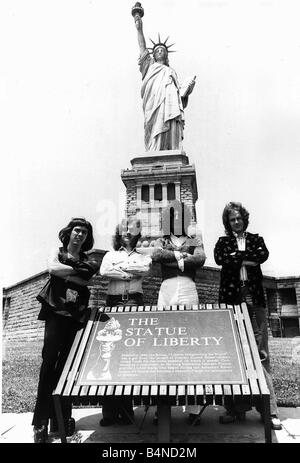 Slade pop group visit The Statue of Liberty 1975 Dave Hill Noddy Holder Don Powell and Jimmy Lea - Stock Photo