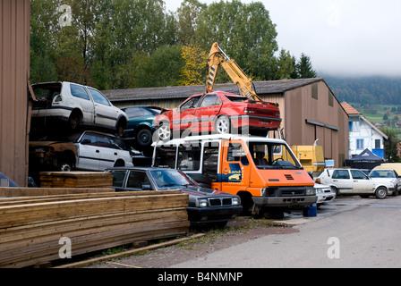 Junkyard : Cars, bus sit in the junkyard - Stock Photo