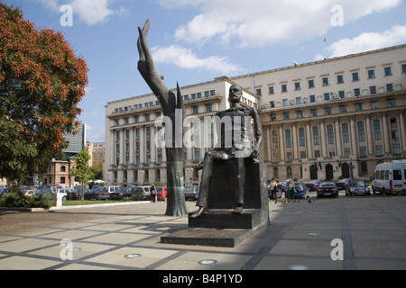 Bucharest Romania Europe EU Hand and Bronze statue of Iuliu Maniu politician known as the Broken Man in Revolution - Stock Photo