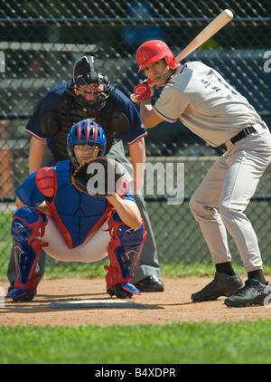 Baseball pitcher, batter and umpire in ready position - Stock Photo