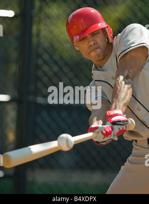 Baseball batter hitting ball - Stock Photo