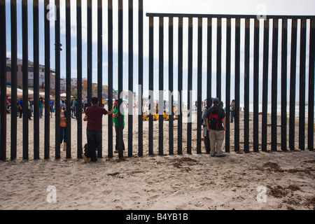 People meeting across the International Border between Mexico and the United States. - Stock Photo