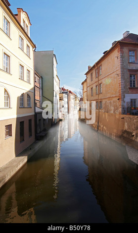 early morning mist above Certovka brook - city district Mala Strana in historical centre of Prague - Stock Photo