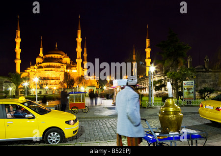 Taxi drivers wait along with simit Turkish bagels and tea vendors in front of the Blue Mosque. Turkey, Istanbul, - Stock Photo