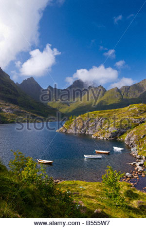 Fishing boats on lake Ågvatnet, with the peaks of Mannen and Gjerdtindan in the background, near Å, Lofoten Islands, - Stock Photo
