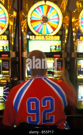 Gambler at a Slot Machine at Casino MGM Grand in Las Vegas Nevada USA - Stock Photo
