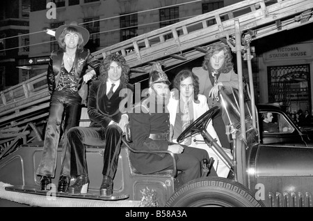The Slade pop group on fire engine. L to R Dave Hill, Don Powell, Jimmy Lea, Noddy Holder. February 1975 75-00872 - Stock Photo