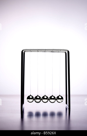 Newtons cradle office game balls - Stock Photo