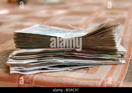 Pile of Uzbek sums, Uzbekistan - Stock Photo