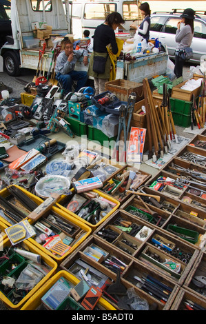 Hardware and tools being sold at monthly flea market at Toji Temple, Kyoto, Honshu Island, Japan - Stock Photo