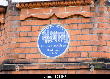 A historic blue plaque honoring D.H. Lawrence -- author, poet and playwright -- on a home in Hampstead, North of - Stock Photo