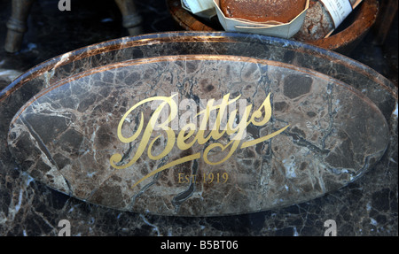 Bettys tea room window sign in Harrogate Yorkshire October 2008 Photo by Simon Dack - Stock Photo