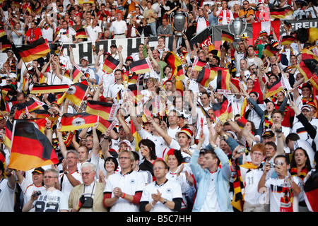 German supporters cheer their team prior to the start of a UEFA Euro 2008 group stage match against Austria. - Stock Photo