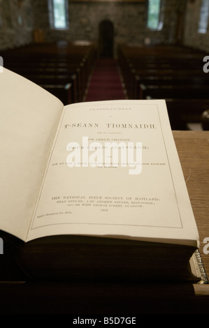 vicars view from the pulpit apse of a church looking over the holy bible in gaelic down the aisle across the pews - Stock Photo